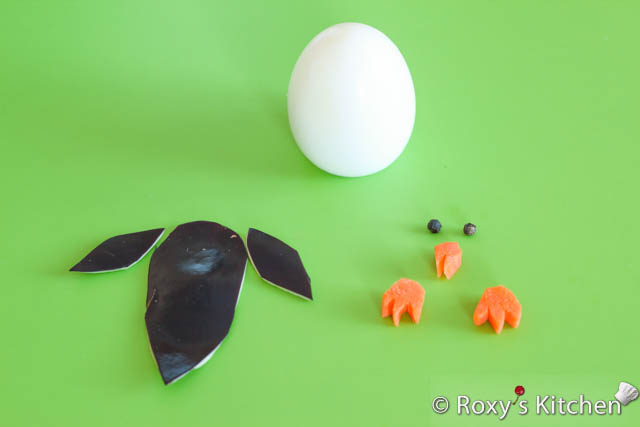 Egg Penguins - Make the feet and beak out of carrot and the wings and back out of eggplant skin.