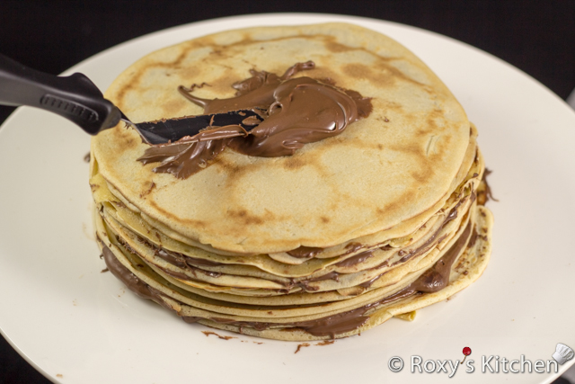 Nutella Crepe Cake – A Unique and Simple Easter Dessert - Spread about one tablespoon of Nutella between each crepe.