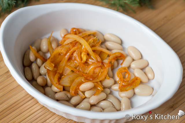 5-Ingredient Beans with Roasted Peppers and Onions -  In an oven-proof dish add 1/3 of the beans, half of the cooked onions.