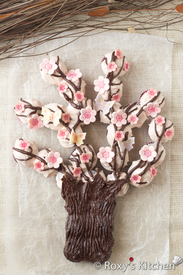 Spring Blossom Tree Made Out of Cupcakes | Roxy's Kitchen #cupcakes #Spring #dessert #flowers #butterflies #fondant