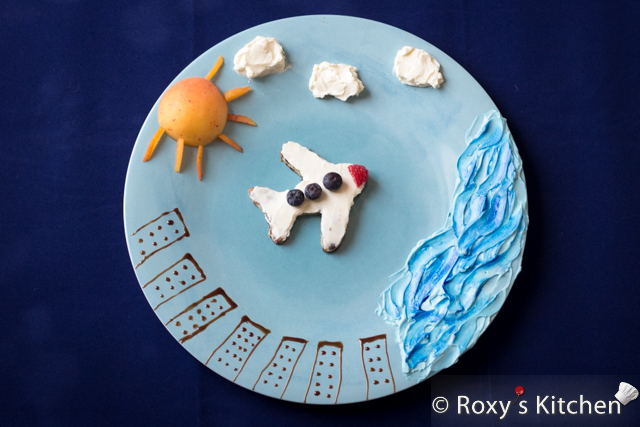 Wordless Wednesdays - Flying across the Atlantic ocean. Canada, here we come! | Roxy's Kitchen #airplane #foodart #creativefood #clouds #ocean #sun #buildings #apricot #creamcheese #chocolate #berries #toast