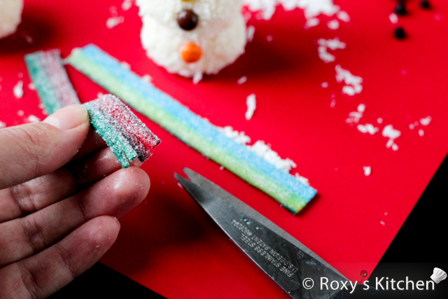 Homemade Raffaello Snowmen - Cut each sour candy belt in four and cut slits in the ends to create a frayed scarf look.