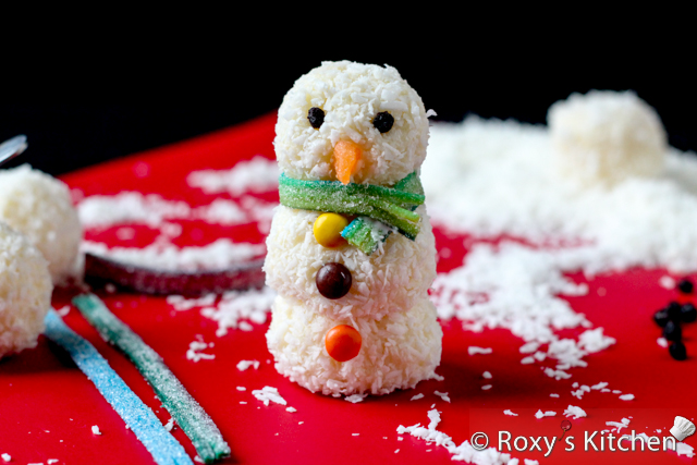 Homemade Raffaello Snowmen - Add some candy coating around the neck area and wrap the scarf around.