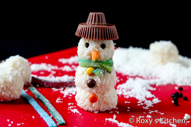 Homemade Raffaello Snowmen - Place a small peanut butter cup on top of a larger one to make the hat and attach it to the snowman using candy coating as glue.