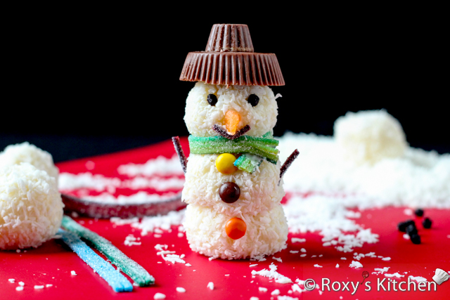 Homemade Raffaello Snowmen -  Cut out a few thin strips out of the sour candy belts to make the mouth and arms and attach them to the snowman using candy coating again.