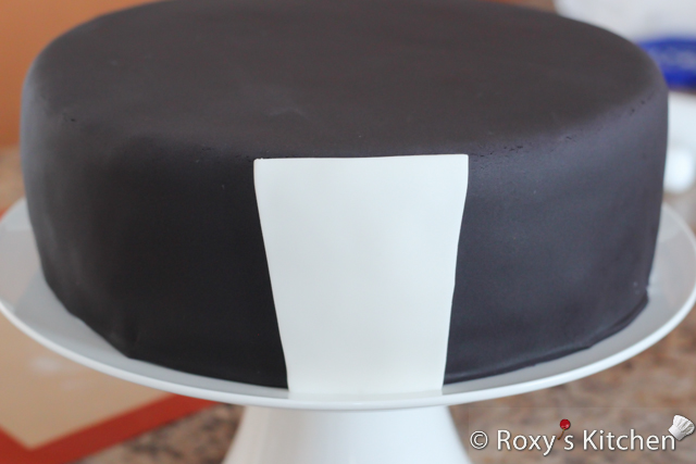 Tuxedo Cake with Striped Bow Tie - Brush the back of the shirt with some edible glue or water and attach to the cake.