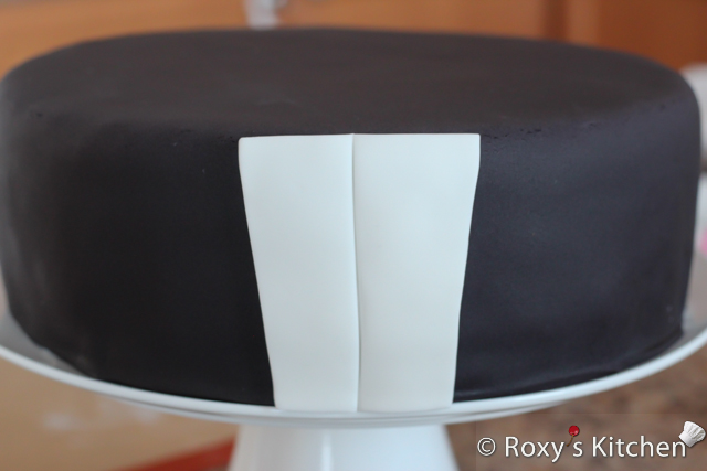 Tuxedo Cake with Striped Bow Tie - Take a knife, pizza roller or sticking tool and trace a line from top to bottom to make the button line. Make sure you don't cut it all the way through.
